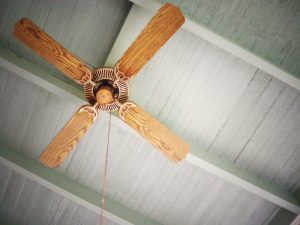 wooden ceiling fan on a grey ceiling